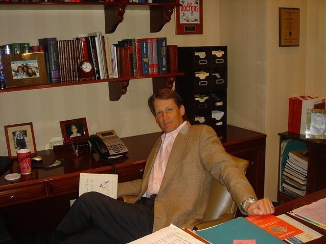 Dr. Thorne at desk